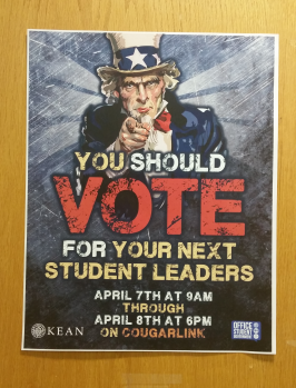 The Student Government Organization's election flyer hangs on their office's door in the University Center.