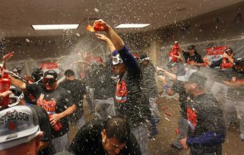 The Mets celebrate their first NL East Pennant since 2006. Photo: Getty Images/ John Sommers II