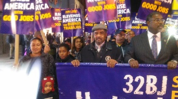 Rev. Michael Blackwell, center, stands with East Orange Mayor Lester Taylor, right, at a protest in Newark for higher wages for airport employees.  (Photo courtesy of Rev. Blackwell)