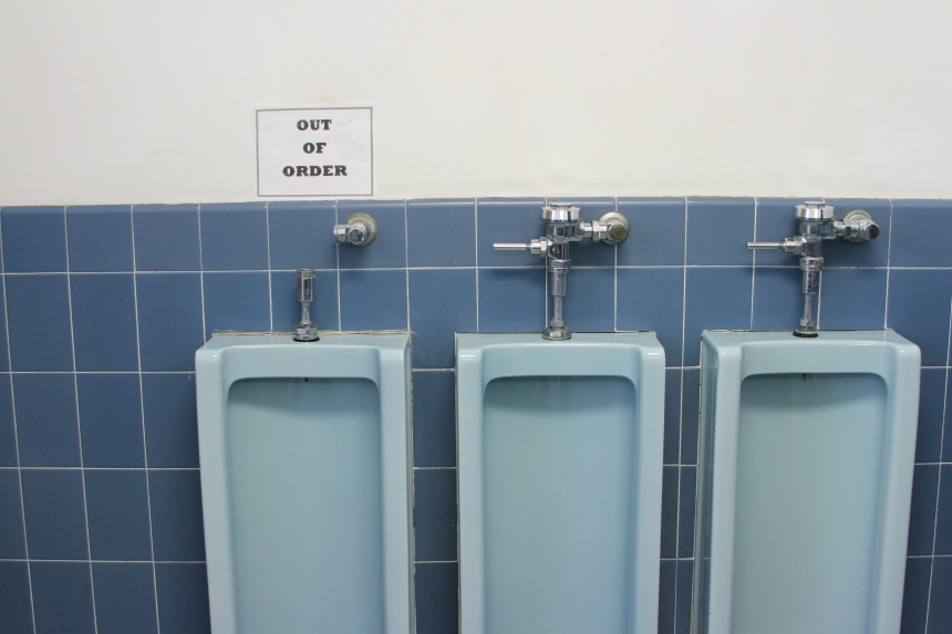 A non-functioning urinal without a handle at Townsend Hall. Photo: Anthony N. Muccigrossi