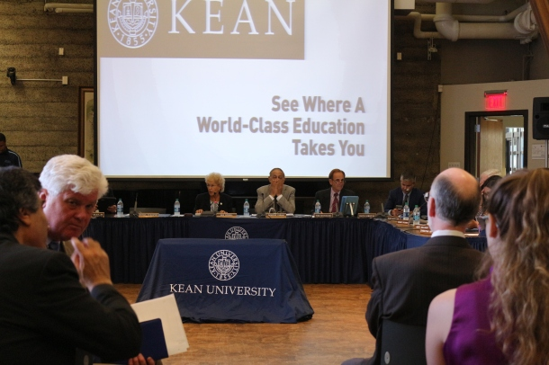 Kean University President Dawood Farahi, center, sits with Board of Trustees members before the start of Monday's trustees meeting. June 27, 2016. Credit: Rebecca Panico